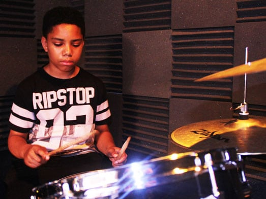 teenage-boy-playing-drums